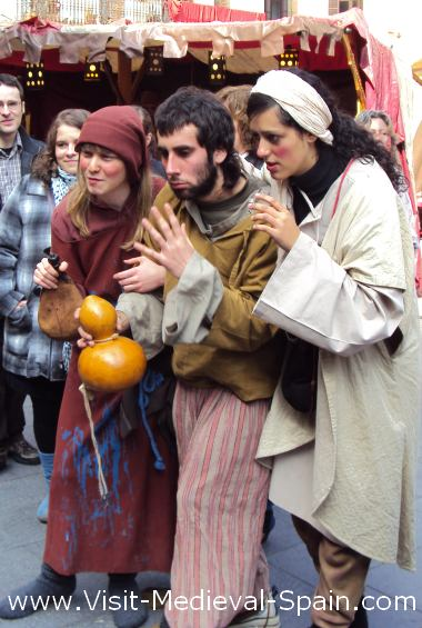 A group of medieval town drunks enjoy a drop of Spanish wine.Febuary 2011 Manresa Medieval Fair, Catalonia Spain