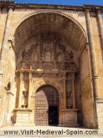 The ornately carved main entrance to the cathedral of Alarcon, Spain