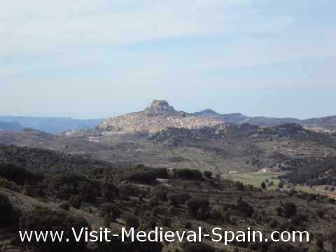 The medieval castle and town sit dramatically atop a hill which overlooks the surrounding Spanish countryside