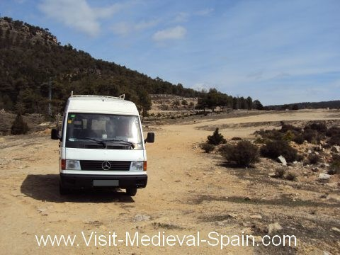 A white Mercedes camper van parked off road in the spanish countryside