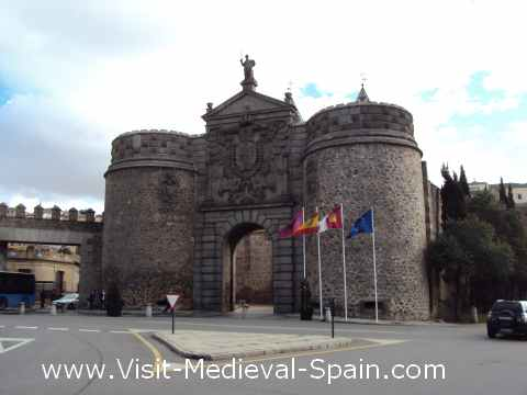 The flags of Toledo, Catite, Spain and Europe flying in front of the  Puerta Nueva Bisagra gate, Toledo.