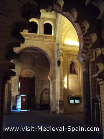 Photo of the painted interior of the San Roman Church, Toledo. The photo is slightly blurred due to low light but shows the rich decorations of this church which is now a Visigoth museum.