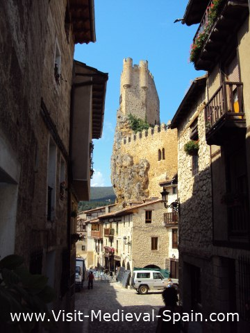 The medieval castle towers over the tiny village of Frias, Castile - Spain