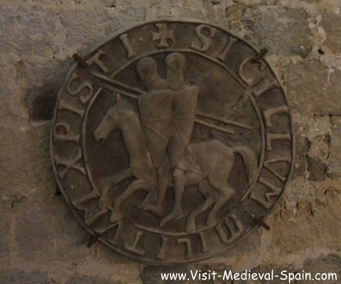 Medieval shield showing the Knights Templar on the wall in a Castle,Peniscola Spain