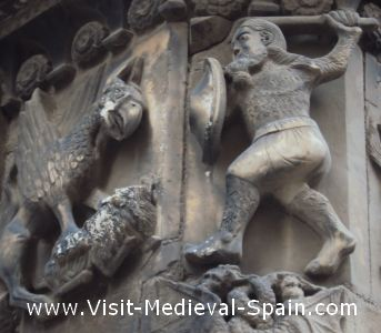 Stone carving on the facade of Barcelona's 13th Century Medieval Cathedral showing the Catalan hero Wilfred the Hairy killing a dragon