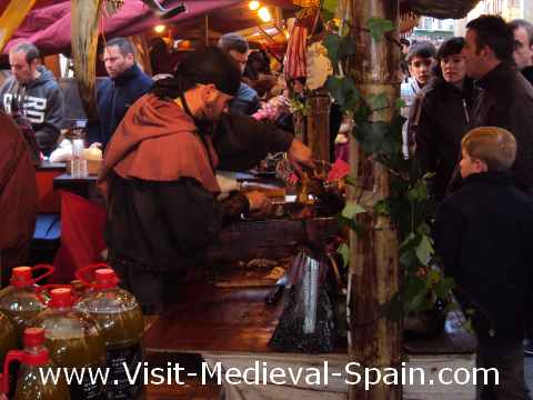 Stallholder carving meat at the 2012 medieval fair of Vic near Barcelona, Spain