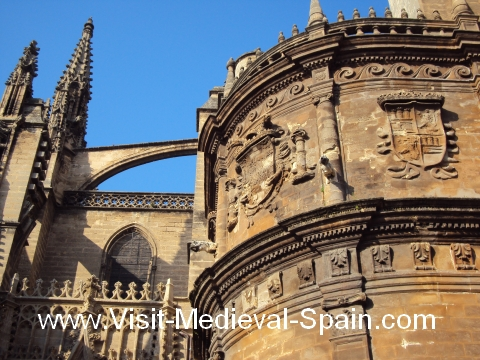 Butresses and carvings on the walls of Seville's medieval cathedral, Seville, Andalusia, Spain