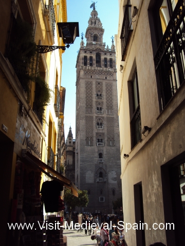 View down a narrow alley to the Giralda Tower, Seville