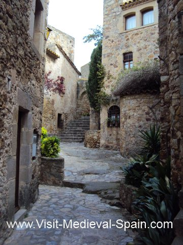Cobbled streets winding between the medieval houses in Pals Northern Spain.