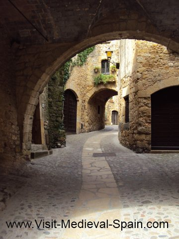 Medieval stone arches in Pals a tiny village near Girona, Spain