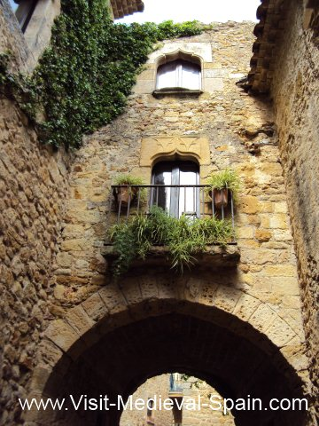 Typical stone arches and balconies of medieval houses in Spain.